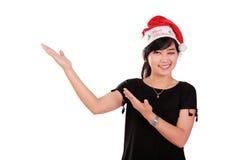 Cheerful Christmas girl doing presentation stock image