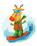 Cheerful Christmas reindeer snowboarding. Stock Image