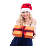 Cheerful Christmas woman giving present Stock Photo