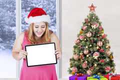 Cheerful christmas woman holds empty board Stock Photos