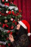Cheerful christmas woman wishing Royalty Free Stock Photo