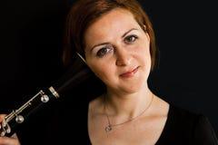 Cheerful clarinetist woman Stock Photos