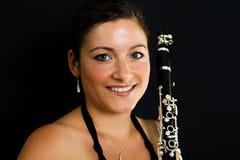 Cheerful clarinetist women Stock Images