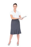 Cheerful classy businesswoman holding newspaper Royalty Free Stock Photo