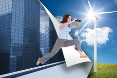 Cheerful classy businesswoman jumping while holding binoculars Royalty Free Stock Photo