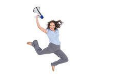 Cheerful classy businesswoman jumping while holding megaphone. Cheerful classy businesswoman on white background jumping while holding megaphone royalty free stock image