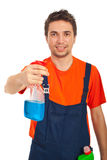 Cheerful cleaning worker man. Holding spray for washing windows isolated on white background Stock Photography