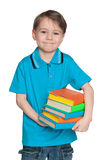 Cheerful clever little boy with books Stock Photos