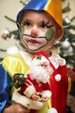 The cheerful clown. Near Christmas tree Royalty Free Stock Image