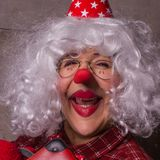 Cheerful clown with blonde wig. Funny clown with blonde wig, glasses and red nose Royalty Free Stock Images