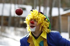 Cheerful Clown Juggler. Belarus city of Gomel. The celebration of the national Russian holiday `Farewell to winter` festival `Maslenitsa`  25.02.2017 year. Clown Royalty Free Stock Photos
