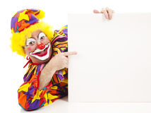 Cheerful Clown Points at Sign royalty free stock images