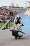 Cheerful clown rides in a bath. MOSCOW - AUG 25: Cheerful clown rides in a bath on Festival of art and film stunt Prometheus in Tushino on August 25, 2012 in Royalty Free Stock Images