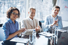 Cheerful colleague clapping their hands Stock Image
