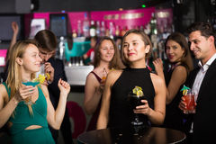 Cheerful colleagues dancing on corporate party Stock Photos