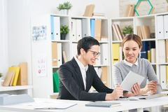 Cheerful Colleagues Making Presentation stock image