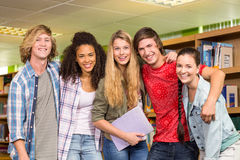 Cheerful college students in library Royalty Free Stock Photography