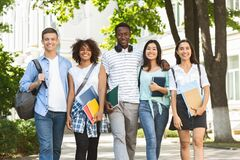 Free Cheerful College Students Walking Out Of Campus Together, Posing Outdoors Stock Image - 175174081
