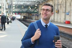 Cheerful commuter having some coffee.  Royalty Free Stock Images