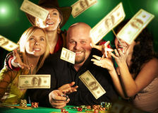 Cheerful company of friends. prize of money. Royalty Free Stock Photos
