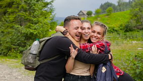 Cheerful company of tourists posing on camera in the mountains stock video footage