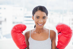 Cheerful competitive model with boxing gloves posing Stock Photo