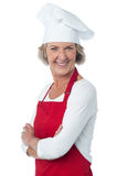 Cheerful confident aged female chef Stock Photography
