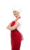 Cheerful confident female chef Stock Images