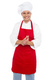 Cheerful confident male chef in proper uniform Royalty Free Stock Image