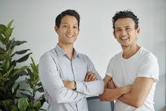 Cheerful confident men stock photography