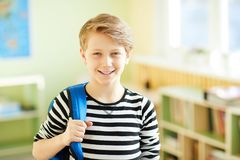 Cheerful confident pupil in corridor Royalty Free Stock Photography