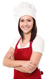 Cheerful confident young female chef Stock Photo