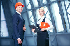 Cheerful construction team is working on new Royalty Free Stock Photos