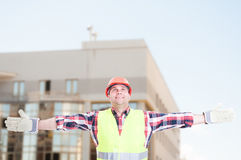 Cheerful constructor celebrating victory Royalty Free Stock Images