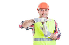 Cheerful constructor doing a timeout gesture Royalty Free Stock Images