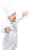 Cheerful cook crazy attacks of kitchen shovel on a white Royalty Free Stock Photos