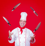 Cheerful cook juggle with knife Stock Image