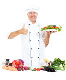 Cheerful cook showing thumbs up Stock Photos