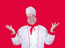 Cheerful cook shows up Stock Photos