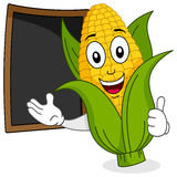Cheerful Corn Cob with Menu Blackboard Stock Photography