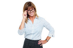 Cheerful corporate lady adjusting her spectacles Royalty Free Stock Photos