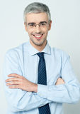 Cheerful corporate man with arms folded Royalty Free Stock Photos