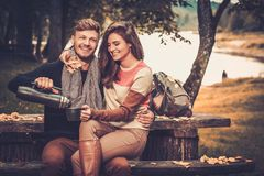 Cheerful couple in autumn park Royalty Free Stock Photo