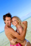 Cheerful couple at the beach Royalty Free Stock Photography
