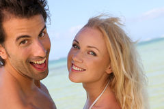 Cheerful couple at the beach Royalty Free Stock Photo