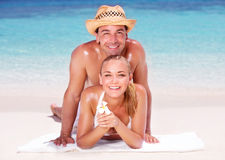 Cheerful couple on the beach Royalty Free Stock Image