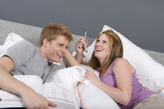 Cheerful Couple In Bedroom Royalty Free Stock Image