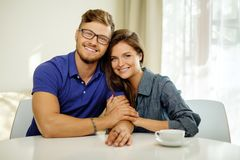Cheerful couple behind table Stock Photography