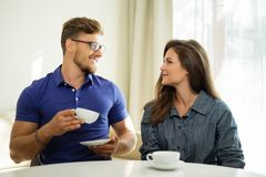 Cheerful couple behind table Stock Images