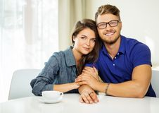 Cheerful couple behind table Royalty Free Stock Images